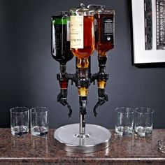 3-Bottle Revolving Liquor Dispenser, from HomeWetBar.com