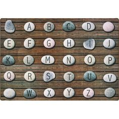 """""""The Alphabet Stones Seating Rug is unlike any rug seen before. This quality carpet uses nature to get children out of their seats and enjoy floor time. Carpets For Kids, Quality Carpets, Kid Picks, Rustic Stone, Wooden Decks, Unique Rugs, Carpet Stains, Pink Rug, Brown And Grey"""
