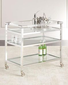 """Handcrafted trolley-style bar cart. Hand-hammered nickel-finished metal frame. Three glass shelves. 31""""W x 18""""D x 29""""T. Assembly required. Imported. Boxed weight, approximately 55 lbs."""