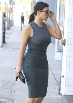 Without a bra: The Keeping Up With The Kardashians star displayed her voluptuous figure during the outing