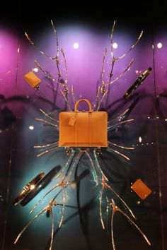 WindowsWear   Louis Vuitton, Milan, November 2012. I thought these were tree limbs......an idea for displaying purses