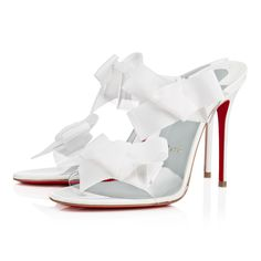 """""""Delicanodo"""" is a feminine and fresh new look for Spring/Summer.  This 100mm single sole mule sandal is fashioned with two transparent PVC straps donning a charming flat bow.  In pristine white, she is perfect with any warm weather silhouette."""