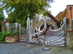 Mythical Dragon Gate Protects Home - My Modern Metropolis - Harlech House Mythical Dragons, Main Gate Design, Protecting Your Home, Iron Gates, Garden Gates, Architecture, My Dream Home, Pergola, Villa