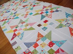 scrap jar stars quilt by lizzie the quilter.  So cute!!!  Tutorial found at alittlebitbiased.blogspot.com