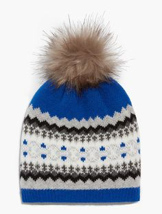 ffa98461dff A cozy Fair Isle hat with a pom-pom detail is our favorite winter accessory