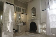 "Fiona's black and white bathroom with fireplace on ""American Horror Story: Coven"""