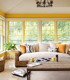 Comfortable looking #sunroom with yellow pops of #color.