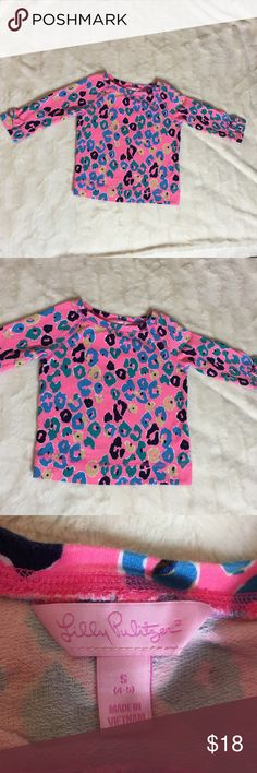 """Girl's Lilly Pulitzer long sleeve Girl's Lily Pulitzer long sleeve top.  Neon pink with blues and greens.  Bows on the sleeves.  Gently used.  Size S 4-5 years old.    Measures 13"""" pit to pit.  Sleeves are 14"""" from collar. Length is 16""""   Check out my other listings to bundle and save 🍑 Lilly Pulitzer Shirts & Tops Tees - Long Sleeve"""