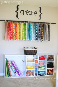 Fabric-storing V - DIY, a curtain rod on the wall + curtain rings {you know, the circles with little clips on them} to hang fabric. Be sure to secure your curtain rod in studs because fabric can be heavy!