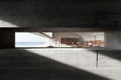 On the shore of an idyllic white sandy beach in Beidaihe New District, a coastal region in eastern China, rests a monolithic yet classical structure that contains sublime spaces of aesthetic illumination. The Seashore Library, designed by the Beijing-based studio Vector Architects in 2015, portrays the endless interaction between the manmade and the natural where light, wind and the sound of the ocean enter uninterrupted into the building's spaces toaccentuate its austere lines.