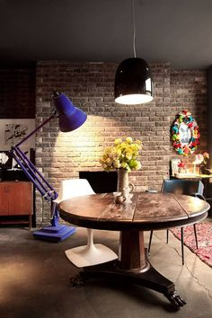 In their open-plan kitchen and living space, is a brick wall – a texture Ah - The Independent