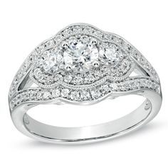 wow i love this 1 CT. T.W. Diamond Vintage-Style Three Stone Engagement Ring in 14K White Gold