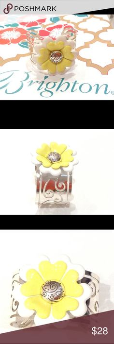 """NWT Brighton Corsage Cuff Bracelet JB4122 NWT Brighton Corsage Cuff bracelet Daisy yellow white silver wide with a cut out swirl design. The center of flower has a silver charm with an etched design. The perfect accessory for so many different outfits. It measures 1,5"""" wide. The daisy is about 2""""x2"""". Brighton Jewelry Bracelets"""
