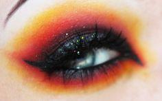 Badass orange and yellow eye makeup.