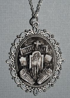 Creepy Cute Gothic Necklace  - Victorian Cemetery Necklace with Tombstones Caskets and Skeleton Hand- Zombie  Vampire via Etsy