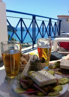 Ahhhhh.....wanna be there!!  Mythos beer and a santorini salad with capers and the best feta you've ever eaten!