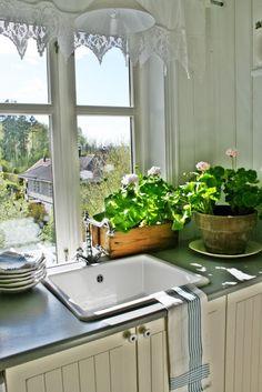 What a view from this farmhouse white kitchen kellyelko.com