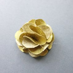 Sparkling up your New Year celebration attire with this Gold Lapel Flower!