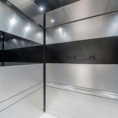 LEVELe-104 Elevator Interior with panels in Stainless Steel with Sandstone finish; Fused Graphite with Mirror finish and custom Eco-Etch pattern; ceiling in Stainless Steel with Mirror finish; Quadrant handrail at Wallace Fortuna, Mumbai, Maharashtra, India