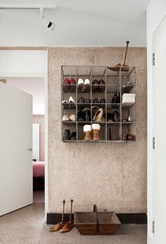 Wall-mounted wire racks give this shoe storage a modern, industrial feel. #diy #shoe #storage