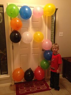 Son turned 5 years old. Take a picture with balloons shaped into the number.