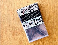 Quickly sweep your bangs aside wherever you are by keeping pins in your purse (and we don't mean loose and jumbled at the bottom). For fun, add pattern to the box with washi tape. Click through for a tutorial and more organizational uses for Tic Tac boxes.