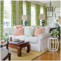 Drapes certainly make the room with their splash of color!