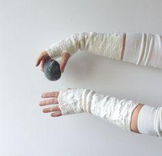 http://www.etsy.com/treasury/NTM5ODkzNXwyNzIzNTg3MzA0/please-mr-snowFelted fingerless gloves Mittens -  white silk wedding. $34.00, via Etsy.
