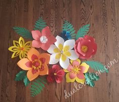 you will receive 8 flowers and 10 leaves flowers sizes varied from 4 inches thru 10 the size of the whole set as see on picture is about 4 by 3 Handmade paper flowers. Can be used as a backdrop, home decor, nursery room, bridal shower, candy table etc The flowers come fully assembled