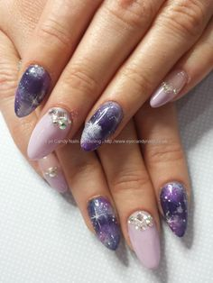 Purple galaxy nail art with swarovski crystals