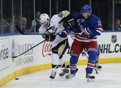 Ryan McDonagh #27 of the New York Rangers Joe Vitale #46 of the Pittsburgh Penguins battle for the puck behind the net in Game Three of the Second Round of the 2014 NHL Stanley Cup Playoffs at Madison Square Garden on May 5, 2014 in New York City. Penguins defeated the Rangers 2-0.