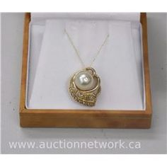14kt Gold Ladies Fancy Pendant with Pearl. - Auction Network
