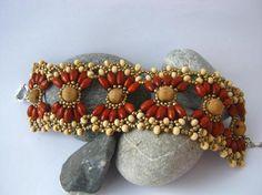 Ажурный браслет из деревянных бусин.   -   Openwork bracelet made of wooden beads.