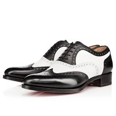 "Gentlemen schooled in classic footwear will fall in love with ""Education Flat.""  This full brogue oxford dress shoe is a stunning rendition of the traditional style.  In black and white brosse leather, he is perfect for the contemporary gentleman looking for a timeless piece to add to his collection of red soles."