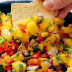Appetizer Recipes Discover Fresh Mango Salsa This simple and colorful mango salsa is super easy to make! Its sweet spicy and absolutely delicious. Serve this fresh mango salsa with chips on tacos or salads or as a salad itself. Authentic Mexican Recipes, Mexican Food Recipes, Mango Salsa Recipes, Salmon Recipes, Best Mango Salsa Recipe Ever, Tropical Salsa Recipe, Salsa Dips, Mango Pineapple Salsa, Shrimp Taco Recipes