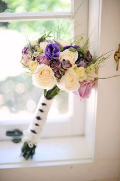 Crystal Creek Flowers incorporated subtle purple accents into the bouquets. Photo by ngg studios, flowers by Crystal Creek Flowers