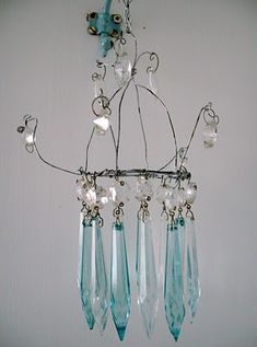 the fisherman's cottage: Handmade Chandelier  My crystals are clear but I think I can do this if it is just wire, beads and crystals.