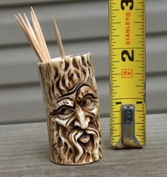 I bought this.  Love it!  (Carved Elk Antler Toothpick Holder)