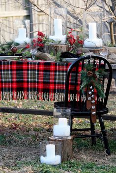 Rustic Outdoor  Christmas tablescape.  Love the idea to use tartan plaid blanket as  tablecloth.