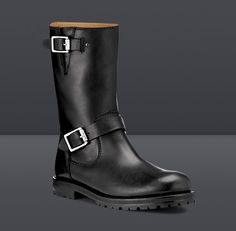 Jimmy Choo - YORK    A rugged, bad-boy masculine boot with utilitarian styling and minimal detail, Available in black calf leather with shearling lining and English pewter buckles.