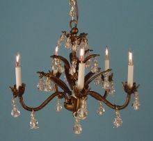 Miniature dollhouse chandelier...bronze finish and crystal drops. From Dollhouse Junction.