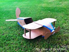 Cardboard airplane photo prop for a litt