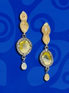 """Yellow Diamonds Never Looked So Good! - """"Smoldering"""" earrings from artist Eve J. Alfillé's newest jewelry design series, """"Homage to Gustav Klimt"""" are one of Diane Alfillé's favorite pieces to make their debut in this collection that was unveiled at the opening party October 19th (the 26th anniversary of the Gallery).  Eve tells us that they derive their power from the ingenious balance of cool & hot. #yellowdiamonds #earrings #klimt"""