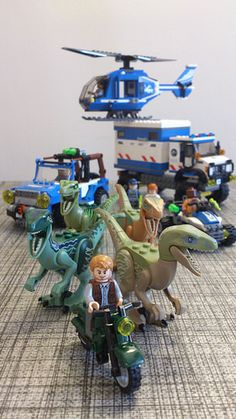 "Jurassic World 2015 (Jurassic Park 4) Lego Raptor Squad Owen Claire Barry ACU Triumph Motorbike Kawasaki Brute Force Jeep Wrangler / Mercedes G 4X4 Unimog Mobiel Veterinary Unit Blue HAwaiian Helicopter ""We're going after it, with everything we've got"" 