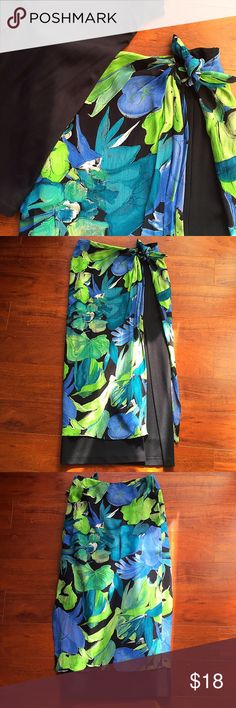 Vintage Floral Midi Skirt Midi skirt with floral tie-waist top layer and black lower layer. 🏝 This is a Florida-based item, and can only be bundled with other Florida items. Please check before purchasing. 🚫TRADES 🚫OUTSIDE TRANSACTIONS ❤️OFFERS WELCOME❤️ Cache Skirts Midi