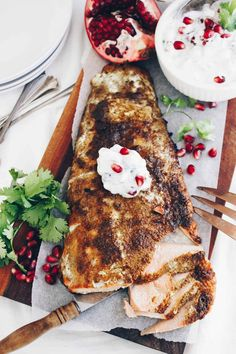 This Tandoori Spiced Salmon with Pomegranate Cucumber Raita is a holiday worthy meal that's bursting with global flavors!