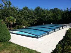 ¡La cubierta de piscina más discreta del mercado, estética y muy práctica! #diseño #piscina  #cubiertasdepiscina