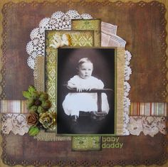 Baby Daddy ~ Sweet heritage baby page in masculine colors. A layered frame of curvy doilies and trims with angled papers, burlap and vintage hankies adds great texture and interest.