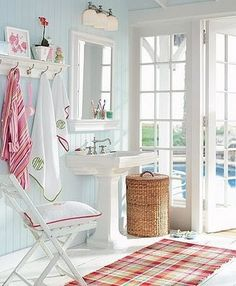 I like the Light Blue & Red color combo. Close to the wall color i am painting my master bath.