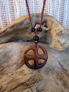 Vishnu symbol. Olive wood necklace by ValleyWWKing on Etsy